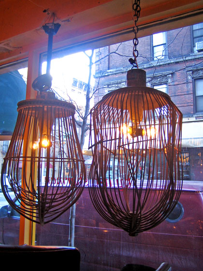 Here we are at another shopping stop, Liza Sherman Antiques, at 37a Bedford Street. And her collection is specializing in French and American furniture and home accessories. These are wire-whisk pendant lamps.