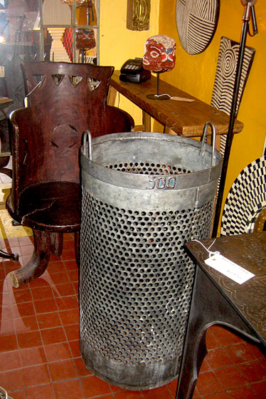 And this is an original metal trash basket from the Bois de Boulogne in Paris, where the trash is burned.