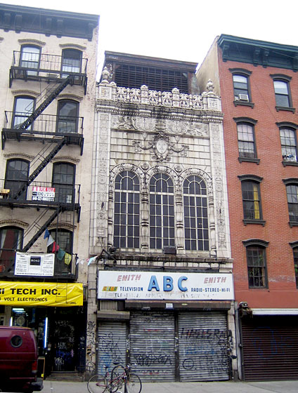 On my way to a scouting appointment, I stopped dead in my tracks when I noticed this building on Division Street between Essex and Ludlow Streets. It's a jewel that has been neglected and has had many lives since its stately origin. Does anyone know anything about it? Please let us know!