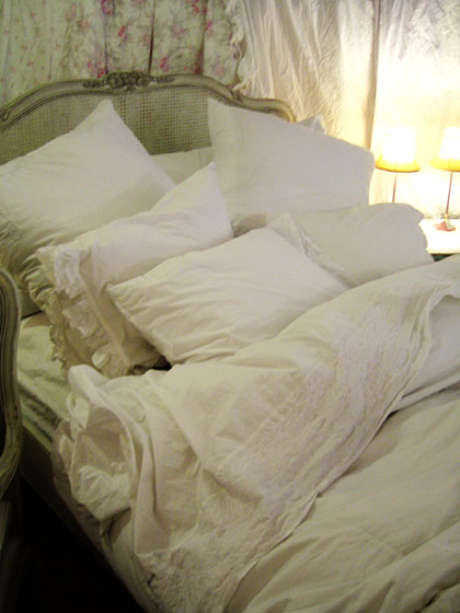 The collection also includes fantastic linens. This bed looks like its straight out of <em>Dangerous Liaisons</em>.