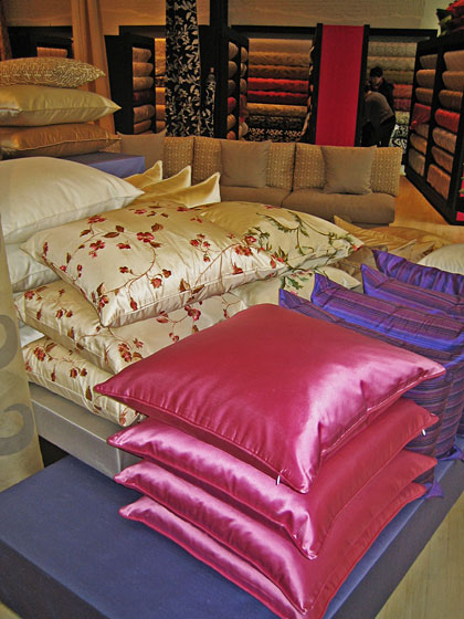 You can purchase ready-made pillows, as seen here, or Kay offers the service of having a pillow made from any fabric in the store.