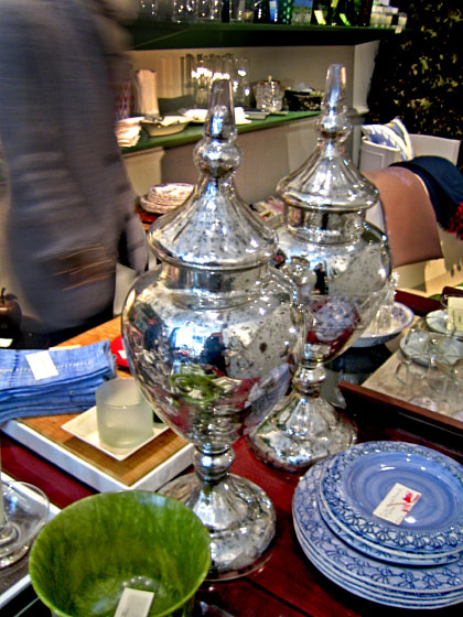 When I visited Georgia and Caroline in the store, I spotted an enticing mix of vintage pieces, such as these mercury-glass urns, along with plates and tabletop items that Georgia picked up in her travels around the world.