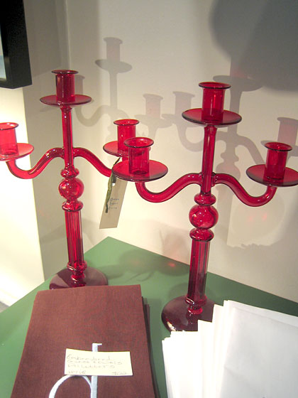 I love the color and shape of these delicate glass candelabras.