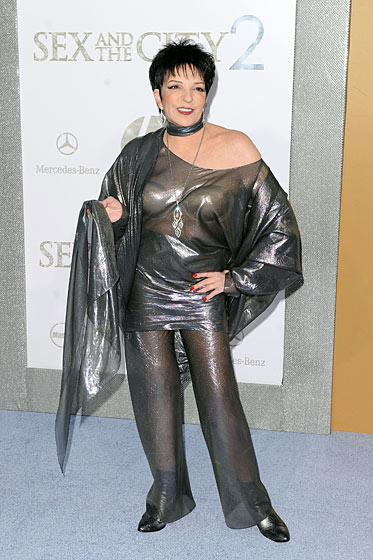 And now, presenting, for the first time ever, Bed Bath & Beyond recession-chic couture, made entirely from shower curtains.