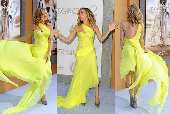 "Carrie wore couture, naturally, by Valentino, from the spring 2010 collection. Lashing around with her neon tentacles, she at once called to mind the movie poster that is on every wall of every subway station around the city and managed to keep her area clear of the Other Three. Because of that movie poster, she owed fans a slit somewhere in her dress, but suffered a slightly embarrassing mishap when she overtwirled and her dress <a href=""http://www.dailymail.co.uk/tvshowbiz/article-1281188/Sex-And-The-City-2-premiere-Sarah-Jessica-Parker-stars-fail-live-stylish-screen-alter-egos-New-York.html"">flew up too high</a>, exposing her undergarments. But it's not like she has cellulite, so it wasn't really that big of a deal."