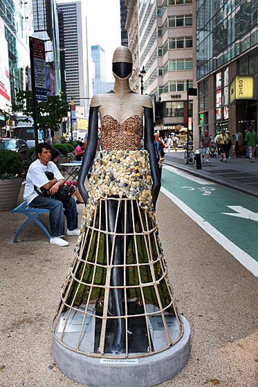 Parsons Students Niyati Karwat and Emily Saunders created a Victorian-caged crinoline as a nod to the Fashion District's 1850s inception. The mannequin's outfit is made entirely of natural materials, and the duo hopes the moss lining the skirt will eventually sprout flowers.