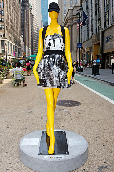 "Donna Karan's taxi-cab-yellow mannequin certainly popped. The designer outfitted her creation in a dress printed with black-and-white photos of New York City, a DKNY baseball cap, and a black backpack pinned with ""I love New York"" buttons (which a PR girl worried might be stolen)."