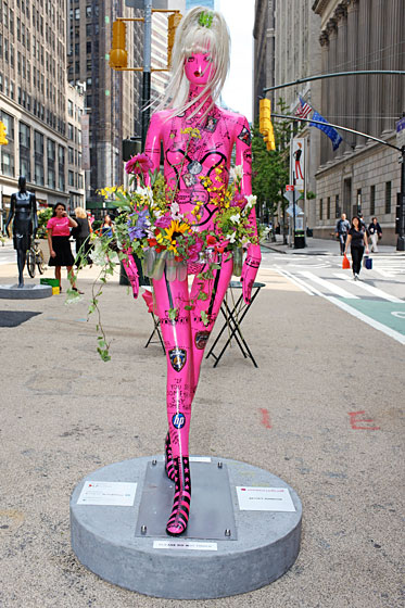 Betsey Johnson covered her mannequin in doodles and personal photographs. The designer even showed up Wednesday night to cut and style its wig. Fun fact: The flowers on the belt aren't fake; they'll be replenished regularly as long as the mannequin is on display.