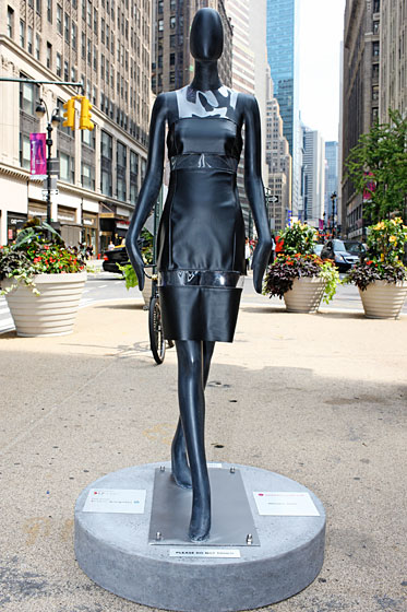 Michael Kors dressed his mannequin in a simple leather-and-plastic shift.