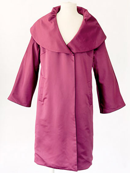 Reversible raspberry satin swing coat, price upon request.