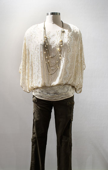 Blank denim olive pants, $78; Beyond Vintage beaded top, $389; Honey & Hive antique pearl necklace, $44.
