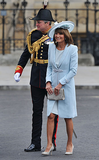 Carole Middleton in a Catherine Walker dress and Jane Corbett hat.