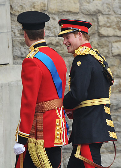 Prince William in a ceremonial uniform for Colonel of the Irish Guards in the British Army; Prince Harry in a ceremonial uniform for Household Cavalry.