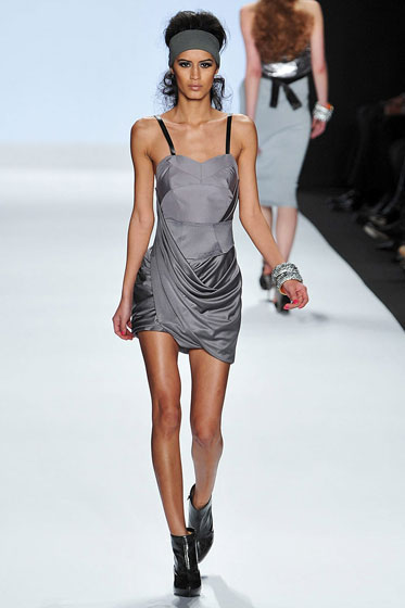 This dress is a little Contempo Casuals, but it works. The draping gives it a nice shape, and that gray is quite chic.