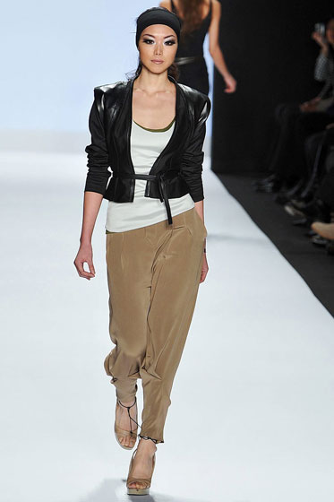 Althea does high-end streetwear with a little leath-a jacket and some tan silk pants.