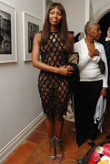 Naomi Campbell wears a fence. And it's awesome.