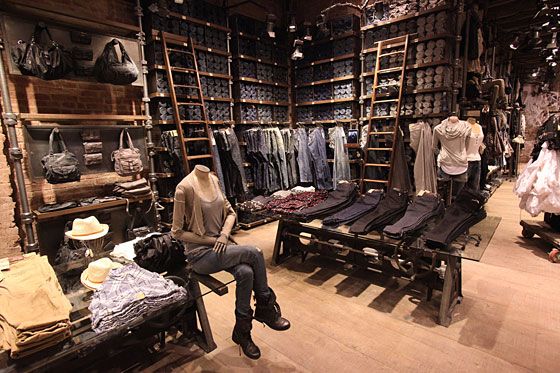 The women's floor touts a full corner stacked with denim.