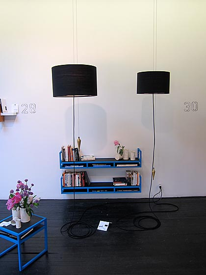 Jason Neufeld's floor-to-ceiling lamps on a pulley system were also featured at the show.