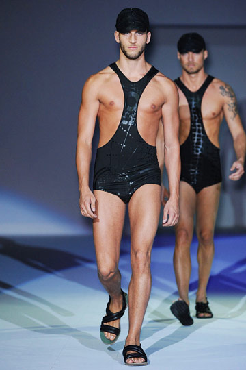 A nipple-baring, wrestler-inspired swimsuit-and-mandals combo at Emporio Armani.