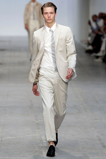 "We saw a <em>lot</em> of off-white suits this season, but <a href=""http://nymag.com/fashion/fashionshows/2011/spring/main/europe/menrunway/costumenational/index1.html#slide32&ss1"">Costume National</a>'s igloo-cool interpretation tucked a skinny black <em>Reservoir Dogs</em>–style tie behind a translucent top. Bonus points for the naked ankles."