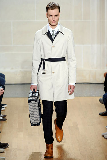 "Every man needs a smart trench. This one from <a href=""http://nymag.com/fashion/fashionshows/2011/spring/main/europe/menrunway/dunhill/#slide24&ss1"">Dunhill</a> is cinched at the waist with a slash of black."