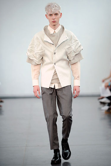 "There is an uncomplicated beauty about <a href=""http://nymag.com/fashion/fashionshows/2011/spring/main/europe/menrunway/gaspardyurkievich/index1.html#slide29&ss1"">Gaspard Yurkievich</a>'s four-button jacket; its sleeves look as delicate as crumpled tissue paper."