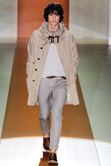"Bravo to <a href=""http://nymag.com/fashion/fashionshows/2011/spring/main/europe/menrunway/gucci/#slide16&ss1"">Gucci</a> for elevating the everyman jacket with a belted neck and swingy bell shape."