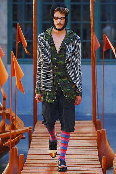 "The <a href=""http://nymag.com/fashion/fashionshows/2011/spring/main/europe/menrunway/henrikvibskov/#slide18&ss1"">Henrik Vibskov</a> show was loaded with crazily printed socks, funky tops, and swim goggles — a look that somehow works here on a very Williamsburg level."