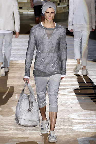 "Lots of designers experimented with sportswear, but <a href=""http://nymag.com/fashion/fashionshows/2011/spring/main/europe/menrunway/iceberg/#slide9&ss1"">Iceberg</a> really nailed it. The sheer weathered pullover, perfectly bunched ribbed-cuff sweats, and jumbo gym bag actually make us want to work out — or at least watch him."
