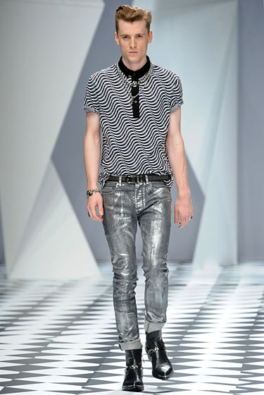 "It was hard to pick just one look from the<a href=""http://nymag.com/fashion/fashionshows/2011/spring/main/europe/menrunway/versace/index1.html#slide30&ss1""> Versace</a> show, but these distressed jeans and this optical-illusion shirt won out. It's soft-core bad boy, like any minute he might hijack a scooter or something."