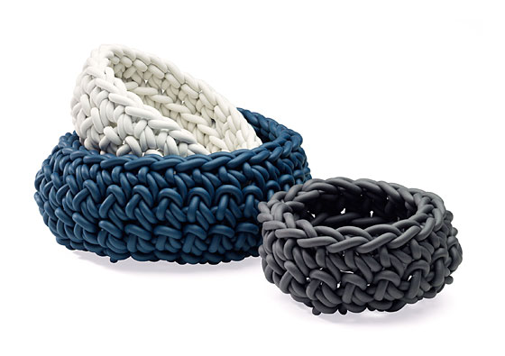 Neoprene yarn is the key material in these flexible, hand-knit baskets. Baskets retail for $45-$115 each, or $220 for the set of three.