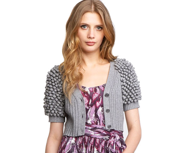 "Juicy Couture loop-sleeve cardigan, $258 <a href=""http://www.neimanmarcus.com/store/catalog/prod.jhtml?itemId=prod111570006&ecid=NMALRFeedJ84DHJLQkR4&ci_src=14110925&ci_sku=T2T0F"">online</a>."