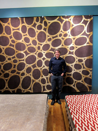"David Rockwell's press breakfast for the launch of his new rug collection was held at <a href=""http://nymag.com/listings/stores/rug-company/"">The Rug Company</a>. Here he is seen standing in front of his Metallic Ovals Blue rug."