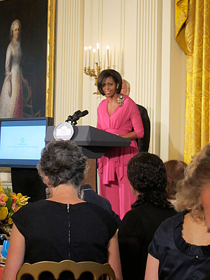 "The ravishing First Lady swept into the room after we were all seated, looking incredible in a fuchsia Isabel Toledo tunic, palazzo pants, and a huge Tom Binns cuff and brooch. After she finished her speech, she sat down at the winners' table, saying, ""And imagine, I get to sit next to Tim Gunn!"""