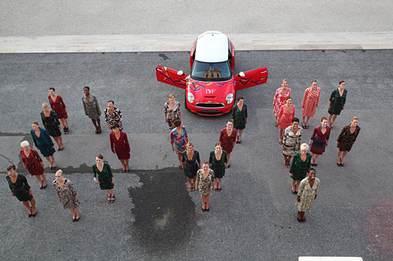The Rockettes pose in front of a DVF-designed Mini Cooper. The car was later auctioned off for charity.