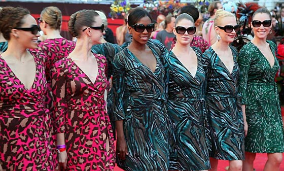 The Rockettes show off the DVF wrap dresses they would've worn during the Life Ball performance; perhaps they should adopt them as the official New York uniform?