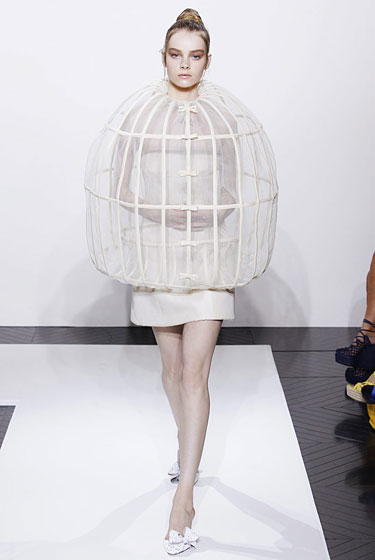You've been wondering what to do with that giant empty birdcage ever since Tweety shuffled off this mortal coil. Duh, wear it. We have no idea how you're going to be able to eat, drive, or sit down in this little number, but if you've got the stones to wear a giant cage out of the house, surely you've got the wherewithal to figure out the details.