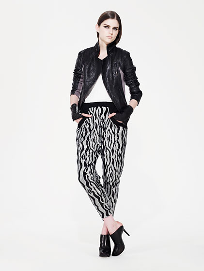 Jet washed lamb leather jacket, $875; optic micro-gauge jersey tank, $128; jet/nickel printed jersey sequin pants, $420.