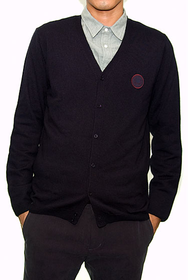 "Raf Simons x Fred Perry V-neck cardigan, $248 at <a href=""http://nymag.com/listings/stores/gargyle/"">Gargyle</a> or <a href=""http://www.gargyle.com/shop/tops/sweaters-sweatshirts/v-neck-cardigan"">online</a>."