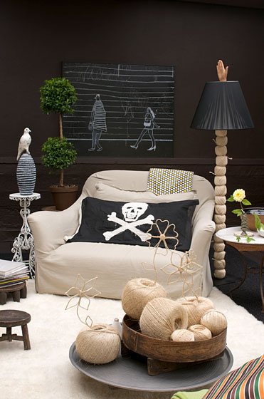 "This extra-comfy armchair is from Verellen at <a href=""http://nymag.com/listings/stores/abc-carpet-and-home-02/"">ABC Carpet & Home</a>. The skull-and-crossbones flag draped over a pillow is from <a href=""http://nymag.com/listings/stores/john_derian01/"">John Derian</a>."