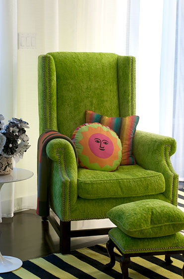 "This wing chair belonged to David's grandmother, and was reupholstered with fuzzy green fabric from <a href=""http://www.designersguild.com/"">Designers Guild</a>."
