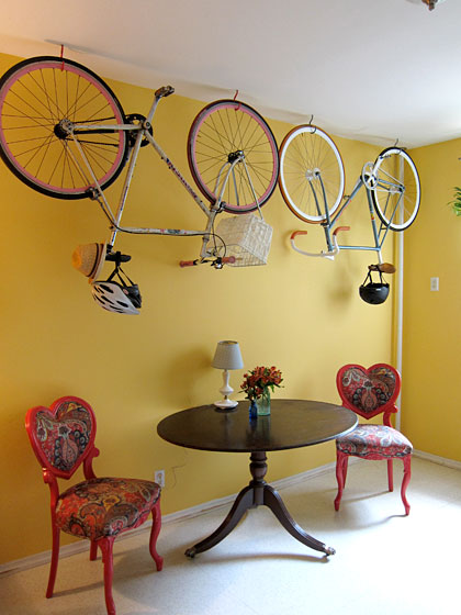 Payton and her fiancé, artist Brian Kaspr, live in Greenpoint, Brooklyn, and park their bikes on the kitchen ceiling. The chairs were a housewarming gift from Payton's mother.