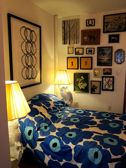 The couple's bedroom is adorned with a Marimekko bed cover, their artwork, and gifts from friends. The owl lamps were found in Baltimore, where Payton lived when she attended the Maryland Institute College of Art. She graduated in 2008.
