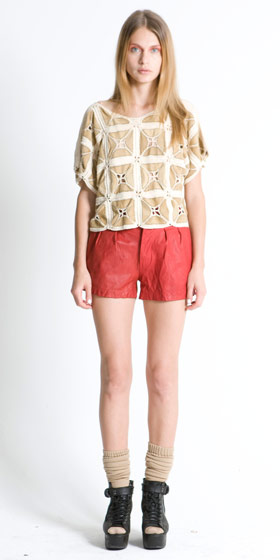 Crochet leather tee, $366; distressed leather high-waist buckle shorts, $389.