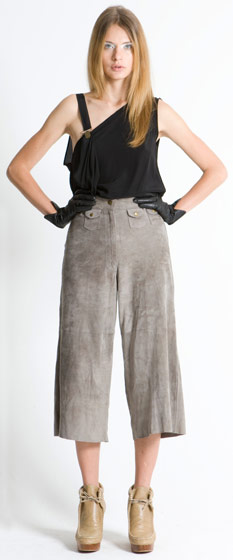 Utility asymmetric clip top, $283; distressed leather suede culottes, $425.