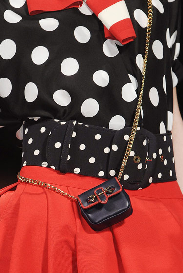 Cross-body change purse at Moschino.