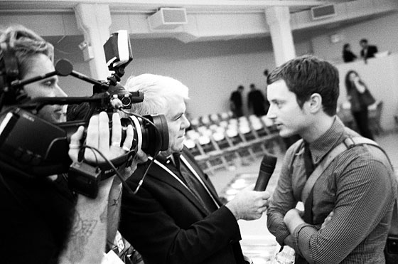 Elijah Wood being interviewed by Tim Blanks at the Rodarte show.
