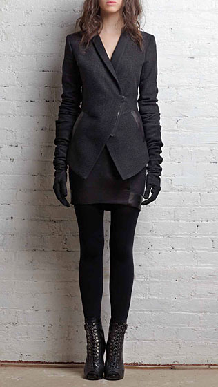 Shawl-collar zip blazer in black wool, $615; lambskin-banded miniskirt in mélange black wool, $315.