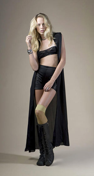 Long silk georgette button shirt, $210; multi-panel bandeau bra top, $120; leather panel shorts, $216.