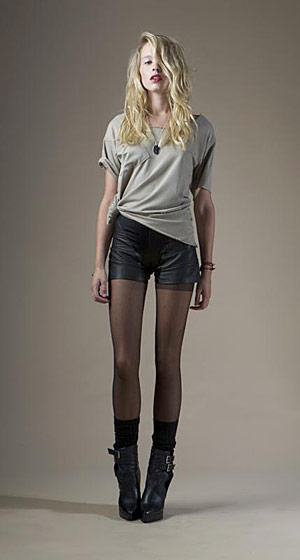 Distressed pocket tee, $108; leather panel shorts, $216.